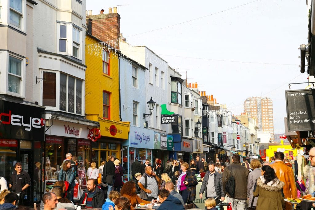 Phot of a crowd outside walking and shopping on North Laine Brighton