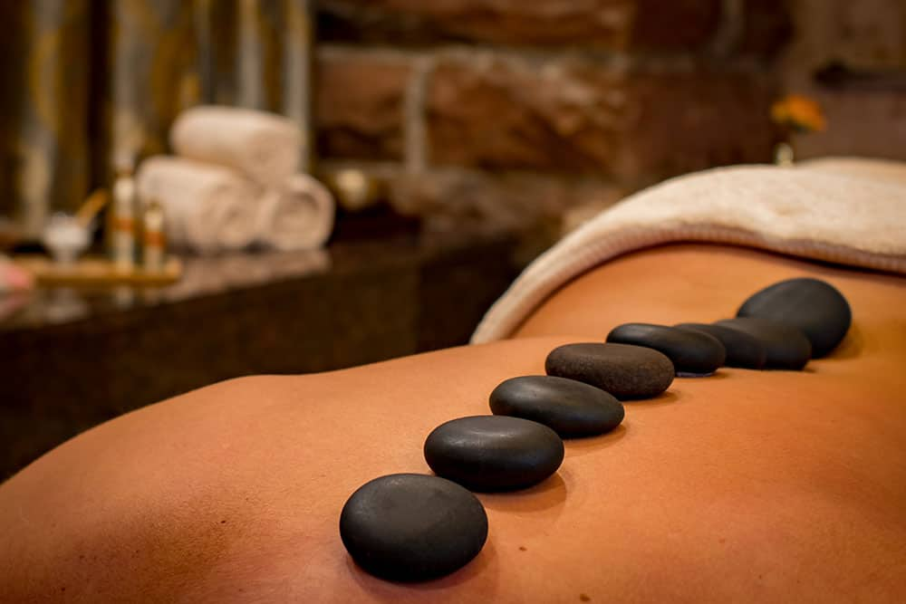 picture with hot stones on a ladies back